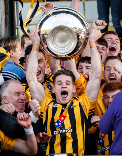 Cathal Finn lifts the trophy