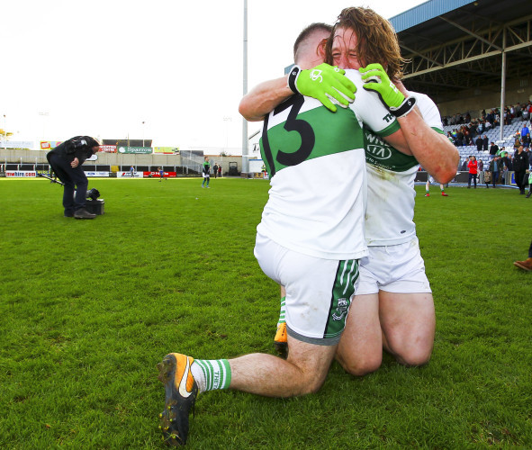 Ricky Maher celebrates with Cahir Healy at the end of the game