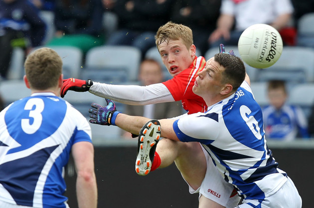 Ciaran Byrne gets his shot away despite the tackle of John O'Loughlin