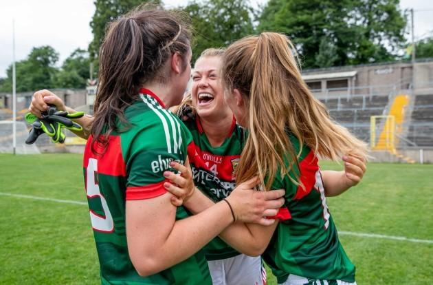Sarah Rowe celebrates with Rachel Kearns and Sarah Mulvihill after the game