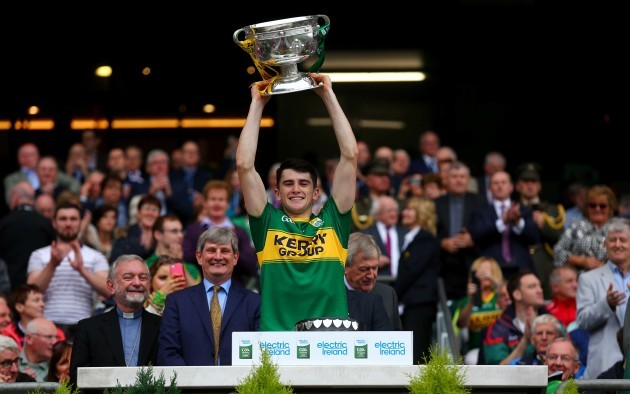 Mark O'Connor lifts the cup