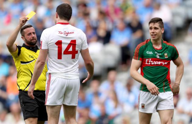Sean Cavanagh is shown a yellow card by Referee David Gough