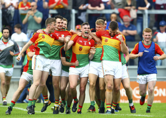 Carlow players celebrate at the final whistle