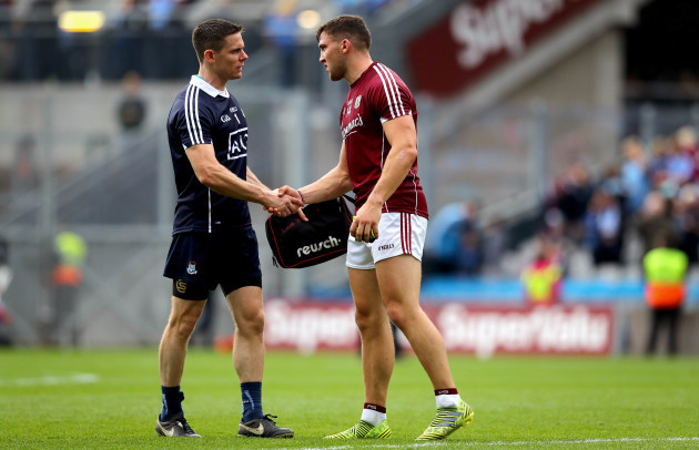 Stephen Cluxton with Damien Comer