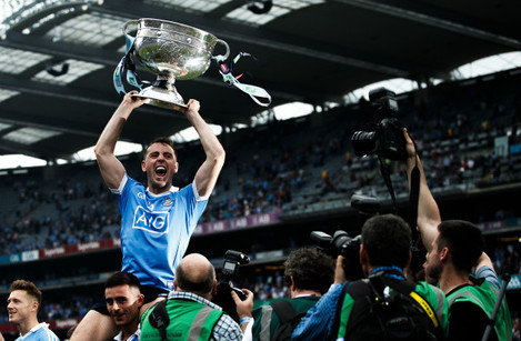 Cormac Costello celebrates after the game with the trophy