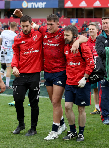 Dan Goggin leaves the field with an injury after the game