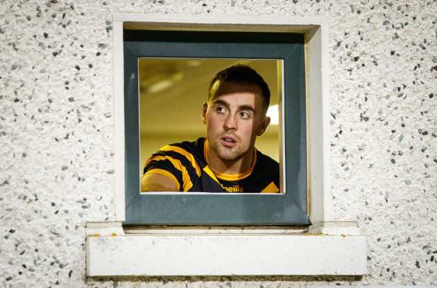 Cormac Doohan looks on from the dressing room before the game