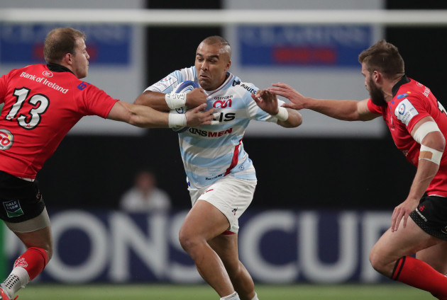 Racing 92's Simon Zebo is tackled by Ulster's Will Addison and  Stuart McCloskey