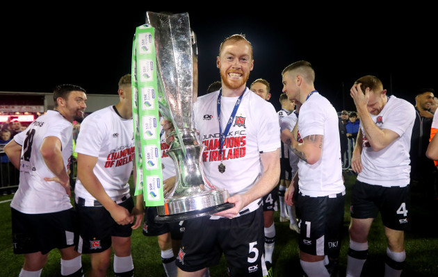 Chris Shields celebrates with the trophy