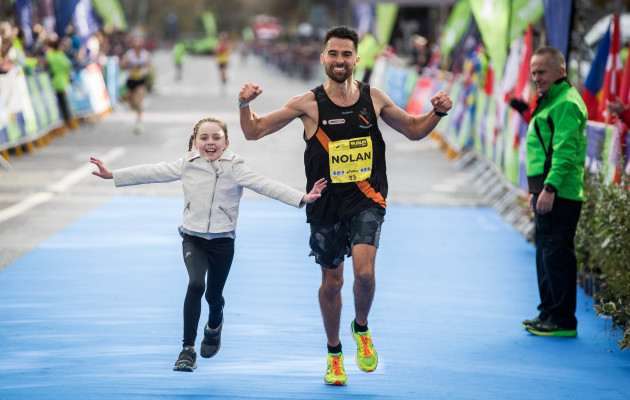 Karl Nolan crosses the line with his daughter Abigail