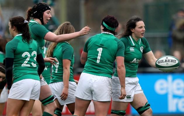 Paula Fitzpatrick celebrates scoring a try