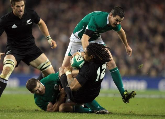 Jonathan Sexton and Gordon D'Arcy tackle Ma'a Nonu