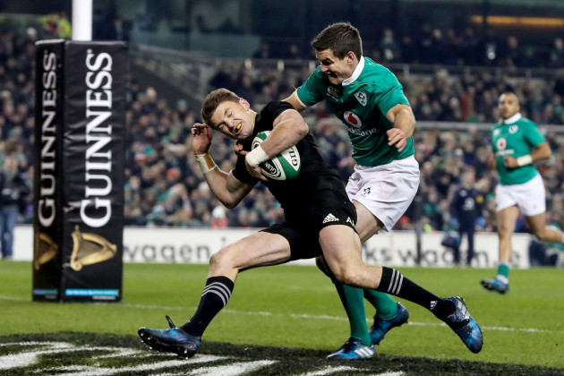Beauden Barrett scoring a try despite the tackle from Johnny Sexton 19/11//2016