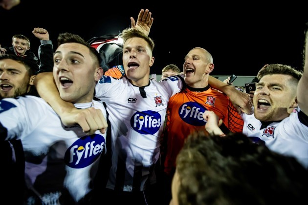 Dylan Connolly, Daniel Cleary, Gary Rogers and Ronan Murray celebrate winning the league