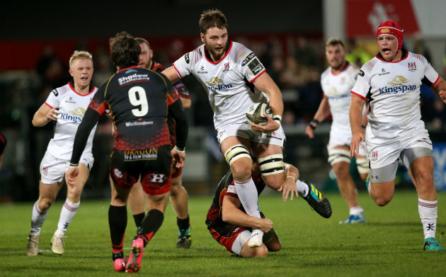 Iain Henderson is tackled by Jarryd Sage