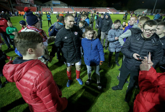 Conan Byrne with fans after the game