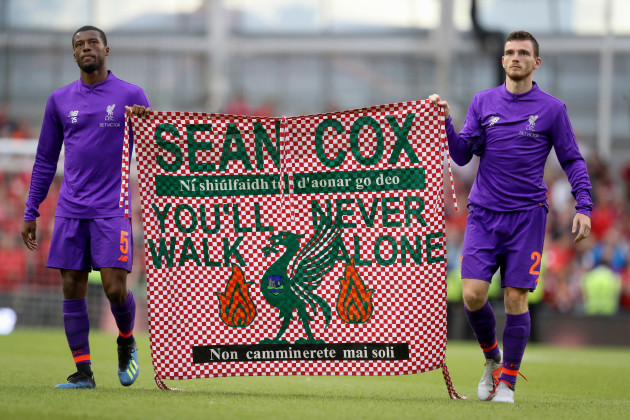 Georginio Wijnaldum and Andrew Robertson with a banner for Sean Cox after the game