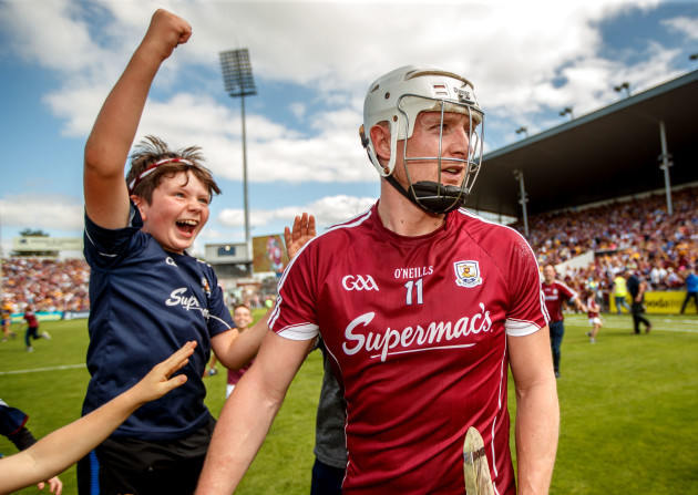 Fans celebrate with Joe Canning after the game