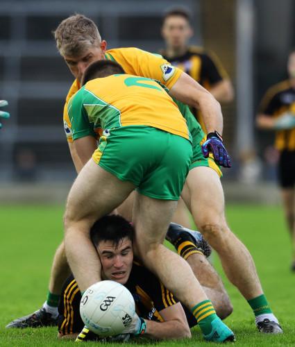 Kieran Fitzgerald and Cathal Silke tackle Barry McHugh