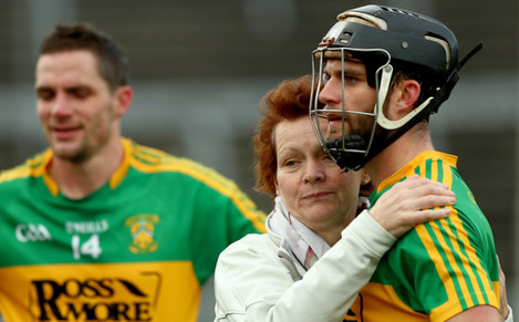Timmy Hammersley and Conor Hammersley consoled by their mother Helen after the game