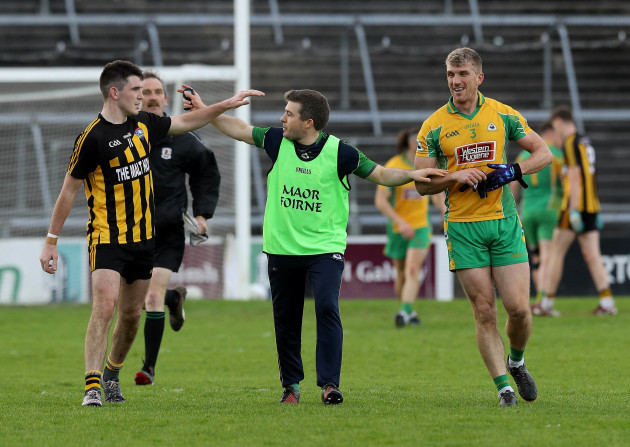 Kieran Fitzgerald and Barry McHugh are kept apart by a Corofin official after both were sent off