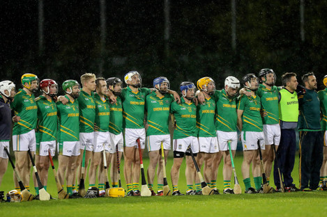 Clonkill players line up for a minute of silence