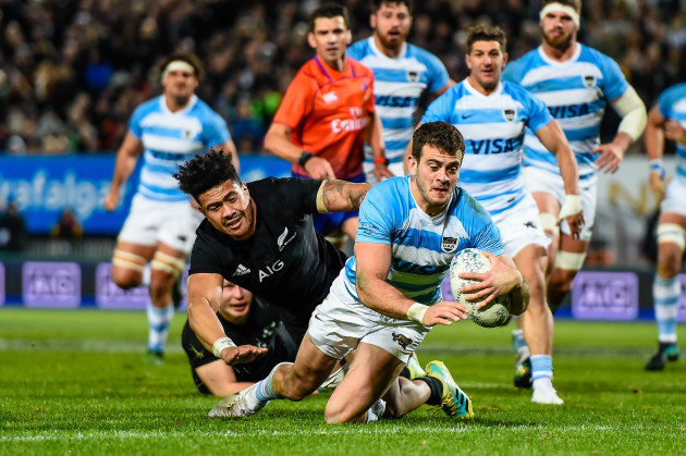 Emiliano Boffelli scores a try despite the tackle from Ardie Savea