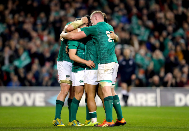 Luke McGrath celebrate scoring a try with Bundee Aki, Peter O'Mahony and Dan Leavy