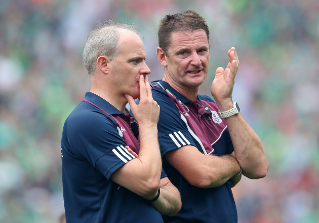 Michael Donoghue and Noel Larkin dejected at the end of the game