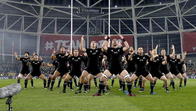 The New Zealand team perform the haka before the game