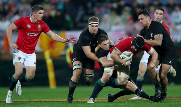 Sam Cane, Beauden Barrett and Codie Taylor tackle Sean O'Brien