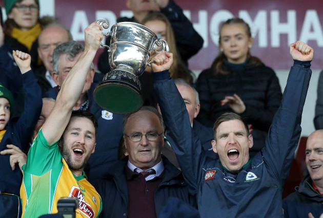 Micheal Lundy and Ciaran McGrath lift the cup