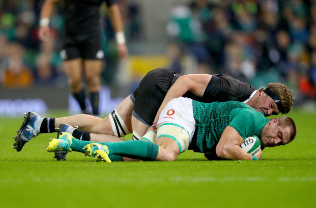 CJ Stander is tackled by Scott Barrett