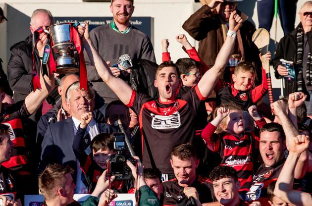 Stephen O'Keeffe raises the trophy with Shane O'Sullivan