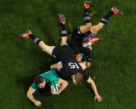 Jacob Stockdale scores a try despite Damian McKenzie and Aaron Smith