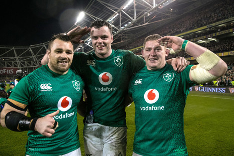Cian Healy, James Ryan and Tadhg Furlong celebrate winning