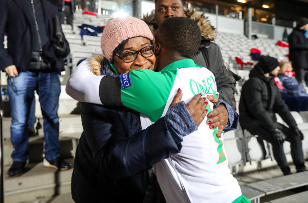Michael Obafemi hugs his mother Bola after the game