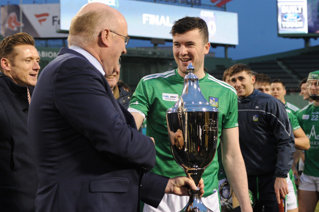 Declan Hannon is presented with the trophy by GAA President John Horan Classic