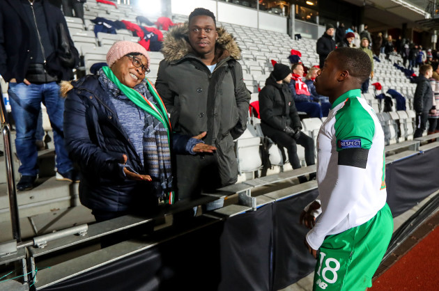 Michael Obafemi with his mother Bola and brother Affy after the game