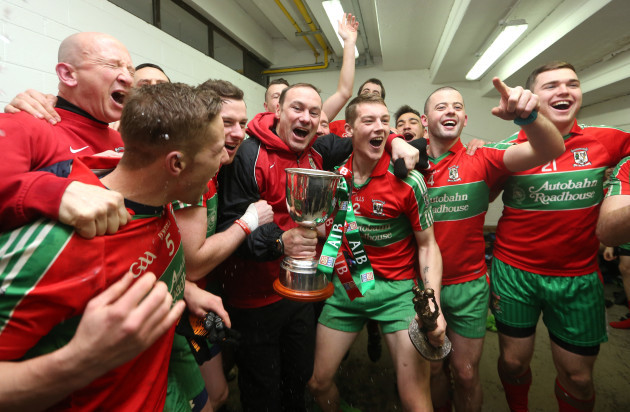 Paul Curran celebrates with his team in the dressing room after the game