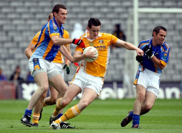 Benny Hasson tackled by Thomas Walsh and John McGrath