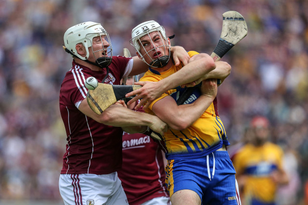 Joe Canning with Conor Cleary battle for possession