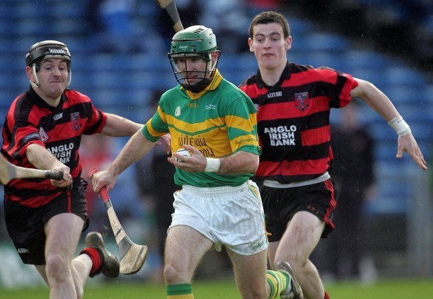 Jerry O'Connor of Newtownshandrum gets ahead of Fergal Hartley and Wayne Hutchinson of Ballygunner 4/12/2005