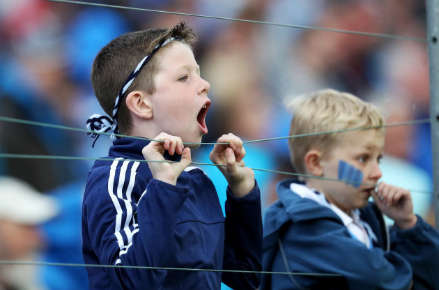 A young Dublin fan cheers on his side