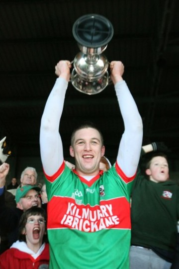 Enda Coughlan lifts the cup