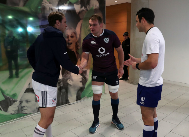 Blaine Scully and Rhys Ruddock with referee Ben O'Keeffe at the coin toss
