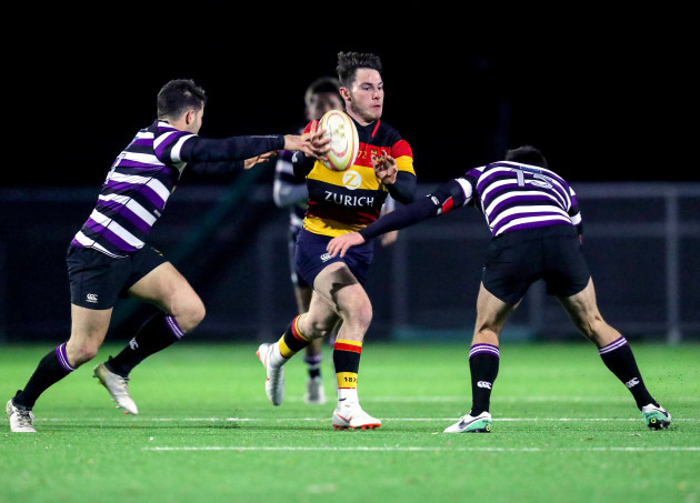 Tom Roche tackled by Matt Byrne and Harry Moore