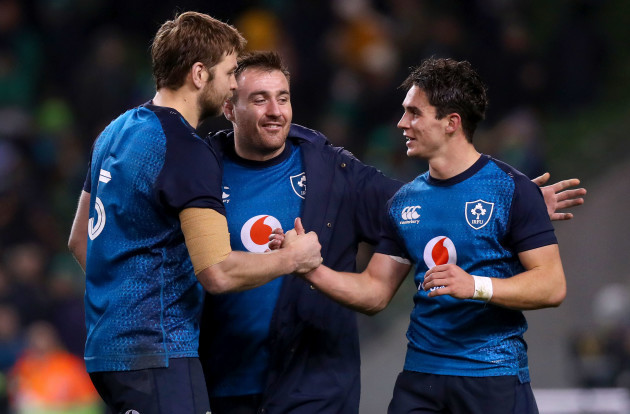 Iain Henderson, Niall Scannell and Joey Carbery celebrate after the game