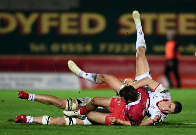 Tom Prydie is tackled by James Hume