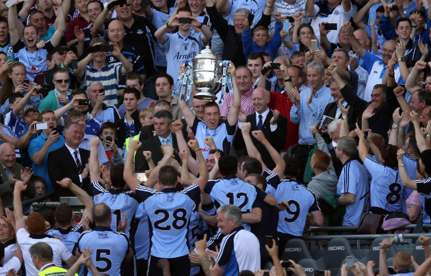 Johnny McCaffrey lifts the Bob O'Keeffe cup